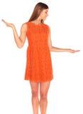 Girl in orange dress on background Royalty Free Stock Photos
