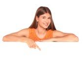 Girl in orange dress behind white board Royalty Free Stock Photo