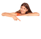 Girl in orange dress behind white board Stock Images