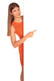 Girl in orange dress behind white board Royalty Free Stock Photography