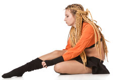 Girl in orange dress with dreadlocks. Royalty Free Stock Image