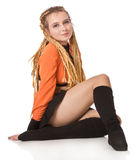 Girl in orange dress with dreadlocks. Royalty Free Stock Images