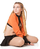 Girl in orange dress with dreadlocks. Stock Image