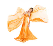 Girl in orange dress flying Stock Images
