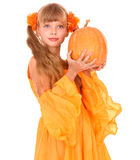 Girl in orange dress with pumpkin at thanksgiving Stock Images