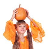 Girl in orange dress with pumpkin at thanksgiving Royalty Free Stock Image
