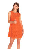 Girl in orange dress on white background Royalty Free Stock Photos