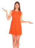 Girl in orange dress on white background Stock Photos