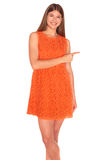 Girl in orange dress on white background Royalty Free Stock Images