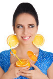 Girl with Orange Drink and Orange Slice Earrings White Background Stock Photos