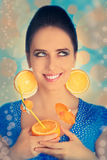 Girl with Orange Drink and Orange Slice Earrings Royalty Free Stock Image