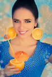 Girl with Orange Drink and Orange Slice Earrings Royalty Free Stock Photography
