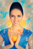 Girl with Orange Drink and Orange Slice Earrings Stock Photography