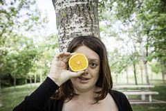 Girl with orange Royalty Free Stock Image