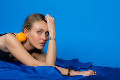 Girl with orange-fruit Royalty Free Stock Photos