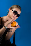 Girl with orange-fruit stock images