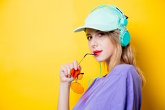 Girl with orange glasses and headphones royalty free stock images