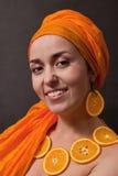 Girl with orange headscarf Stock Images
