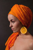 Girl with orange headscarf Stock Photo