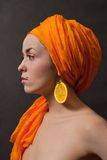 Girl with orange headscarf Stock Photography