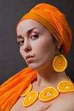 Girl with orange headscarf Royalty Free Stock Images
