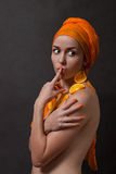 Girl with orange headscarf Stock Photos