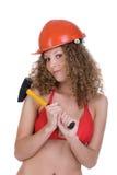 Girl in orange helmet holding yellow hummer Stock Photography