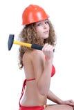 Girl in orange helmet holding yellow hummer Stock Photo