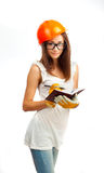 The girl in an orange helmet Royalty Free Stock Image