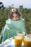 Girl and orange juice. Girl wrapped with a towel after shower ready for breakfast with orange juice Royalty Free Stock Photo