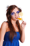 Girl with orange juice in glass Stock Image