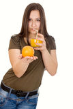 Girl with orange juice and orange in his hand Stock Images