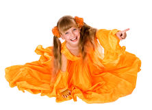 Girl in orange long dress with finger pointing. Royalty Free Stock Image