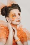 Girl with orange makeup Stock Photo