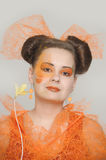 Girl with orange makeup Royalty Free Stock Image