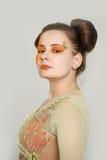 Girl with orange makeup Stock Photos