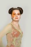Girl with orange makeup Stock Photography