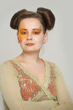 Girl with orange makeup Stock Image