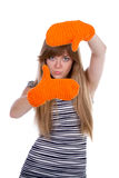 Girl with orange mittens Royalty Free Stock Photography