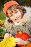 Girl in an orange pumpkin hat Stock Photography