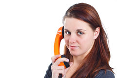 Girl with orange retro telephone Stock Image