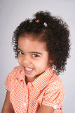 Girl in Orange Shirt. Close up of a young toddler girls brown eyes Royalty Free Stock Photos