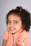 Girl in Orange Shirt. Close up of a young toddler girls brown eyes Stock Photos