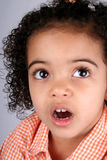 Girl in Orange Shirt. Close up of a young toddler girls brown eyes Stock Photography