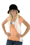 Girl with orange shirt and black hat Stock Photos