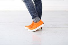 Girl with orange shoes Royalty Free Stock Photos