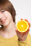 Girl With Orange Slice Stock Images