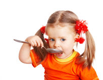 Girl in orange with spoon. Stock Photo