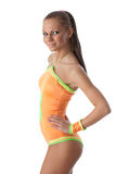 Girl in an orange  swimsuit. Fitness. Royalty Free Stock Image
