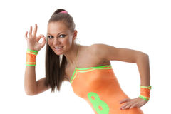 Girl in an orange  swimsuit. Fitness. Royalty Free Stock Images